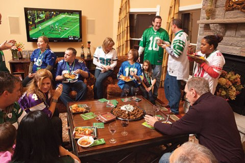 This is not an actual Super Bowl party.  There's a Vikings endzone and several Jets jerseys...
