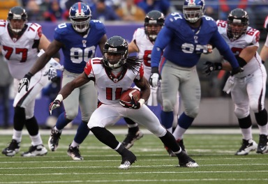 EAST RUTHERFORD, NJ - JANUARY 08: Julio Jones #11 of the Atlanta Falcons runs for yards after the catch against the New York Giants during their NFC Wild Card Playoff game at MetLife Stadium on January 8, 2012 in East Rutherford, New Jersey. (Photo by Nick Laham/Getty Images)