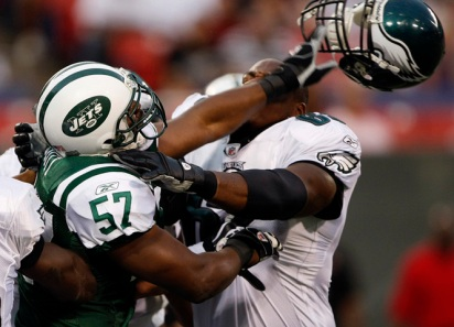 New York Jets' Bart Scott (57) knocks off the helmet of Philadelphia Eagles' Josh Gaines (65) as the 2 teams get into it on the 1st series at the New York Jets vs Philadelphia Eagles in a preseason game at Giants Stadium in East Rutherford, NJ 9/3/09 (William Perlman-The Star-Ledger)