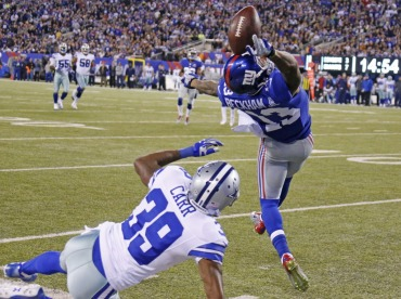 New York Giants wide receiver Odell Beckham (13) makes a spectacular touchdown catch over Dallas Cowboys cornerback Brandon Carr (39)in the second quarter during the Dallas Cowboys vs. the New York Giants NFL football game at MetLife Stadium in east Rutherford, New Jersey on Sunday, November 23, 2014. (Louis DeLuca/The Dallas Morning News)