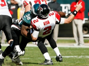 Philadelphia Eagles defensive end Trent Cole (58) tackles Atlanta Falcons quarterback Matt Ryan in the first quarter of an NFL football game against the Atlanta Falcons, Sunday, Oct. 26, 2008, in Philadelphia. (AP Photo/Tom Mihalek)