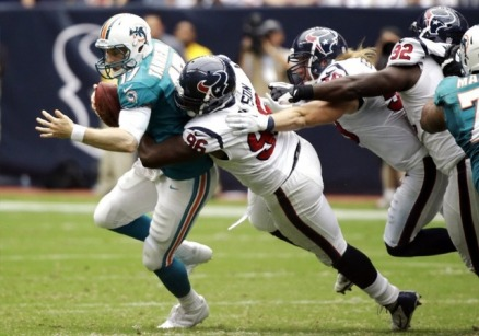 Miami Dolphins quarterback Ryan Tannehill (17) is sacked by Houston Texans defensive end Tim Jamison (96) as Brooks Reed (58) and Earl Mitchell (92) join the tackle during the fourth quarter of an NFL football game, Sunday, Sept. 9, 2012, in Houston. The Texans won 30-10. (AP Photo/Eric Gay)