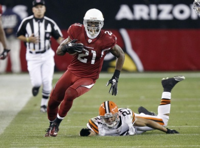 Arizona Cardinals cornerback Patrick Peterson, left, eludes the tackle-attempt of Cleveland Browns defensive back Eric Hagg, right, on a punt return in overtime of an NFL football game on Sunday, Dec. 18, 2011, in Glendale, Ariz. (AP Photo/Paul Connors)