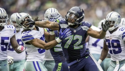 101214 - SEATTLE, WA - Following a fumble recovery by Seattle, tensions get the best of players resulting in a skirmish on the field. Seattle's Michael Bennett throws a punch at Dallas's CJ Spillman. (SEAHAWKS13)